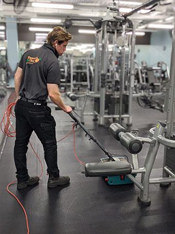 cleaner cleaning gym floor in hobart gym